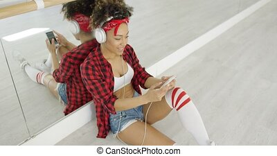 High angle view of attractive female dance student seated...