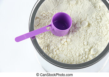 high angle view of baby formula and spoon in can