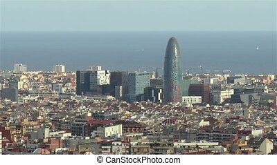 Torre Agbar, Agbar Tower -the bullet building- featured in this high angle view of Barcelona, Spain.