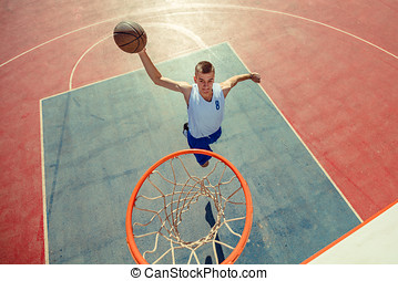 High angle view of basketball player dunking basketball in hoop