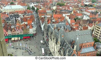 High angle view of Bruges Market Square; traditional buildings and houses in West Flanders, Belgium.