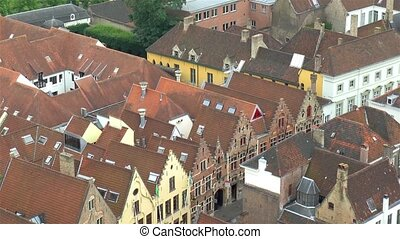 High angle view of medieval Bruges Old Town; traditional houses in West Flanders, Belgium.