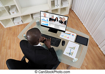 Businessman Video Conferencing With Colleague On Computer