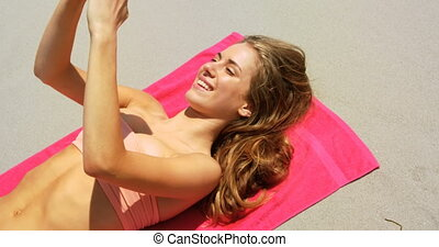 High angle view of Caucasian woman taking selfie with mobile...