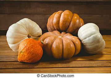 High angle view of colorful pumpkins on table