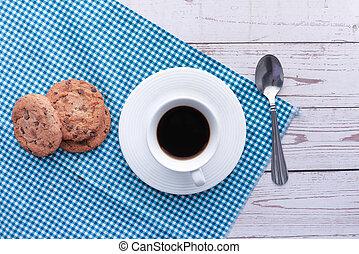 high angle view of cookies and tea on table .