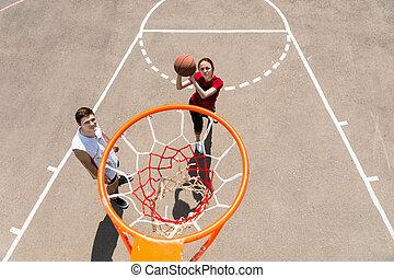 High Angle View of Couple Playing Basketball - High Angle...