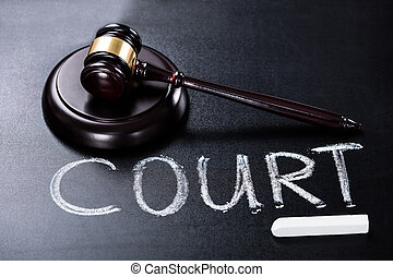 Court Concept With Gavel On Blackboard