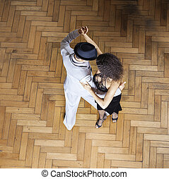 High Angle View Of Dancers Performing On Wooden Floor
