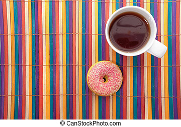 high angle view of donuts and coffee on table.