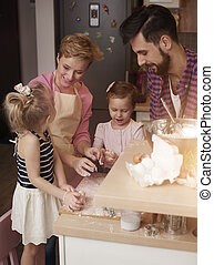 High angle view of family in the kitchen