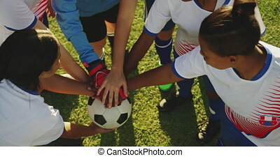 High angle view of female soccer team clasping hands 4k - ...