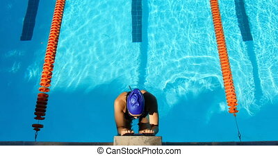High angle view of female swimmer swimming inside pool 4k - ...