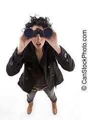 high angle view of female watching through binocular on an...