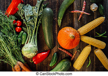 High angle view of fresh vegetables on wooden background.