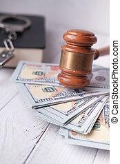 high angle view of gavel and cash on table