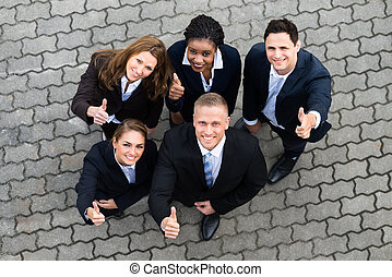 Happy Businesspeople Standing Together