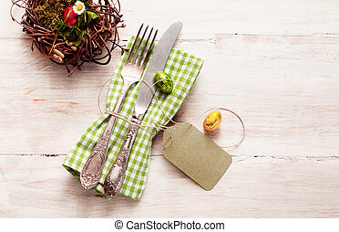 High angle view of happy easter cutlery with napkin