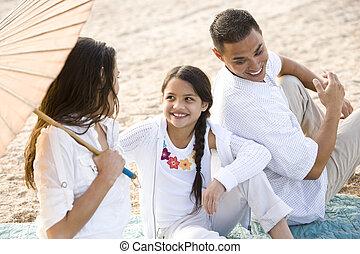 High angle view of happy Hispanic family on beach