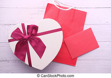 high angle view of heart shape gift on table