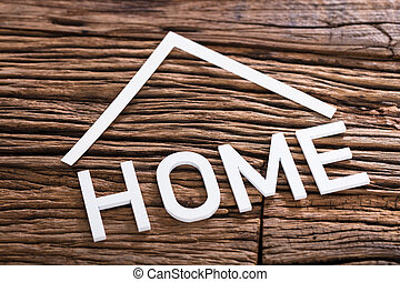 High Angle View Of Home Word On Wooden Background