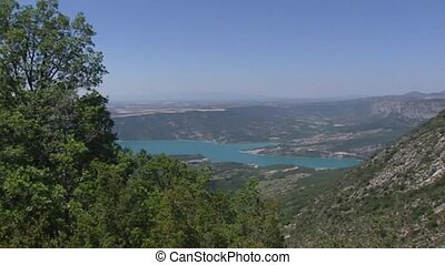 Lake of Sainte-Croix in Verdon, France + pan mountain slope with mountain pass