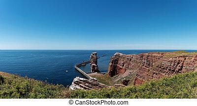 Lange Anna sea stack rock on Heligoland island against blue...