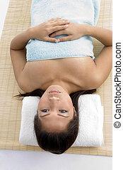 high angle view of laying woman