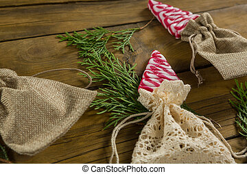 High angle view of mint candies in jute sack with twigs