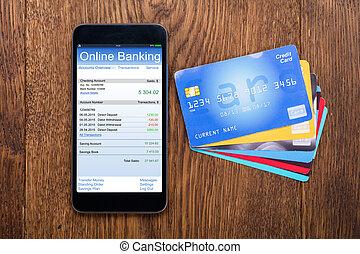 High Angle View Of Mobilephone With Credit Card - High Angle...