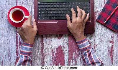 high angle view of person hand typing on keyboard .