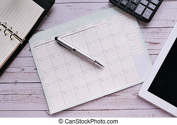 high angle view of planner , diary on office table.