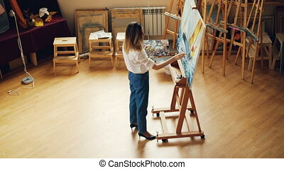 High angle view of professional painter working alone...