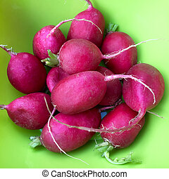 High angle view of radishes in a green bowl