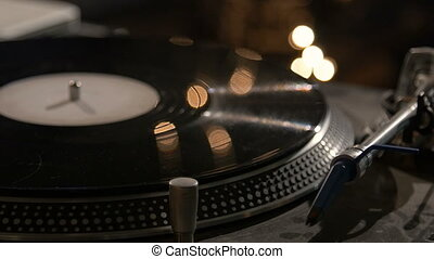 High angle view of record on turntable. - High angle view of...