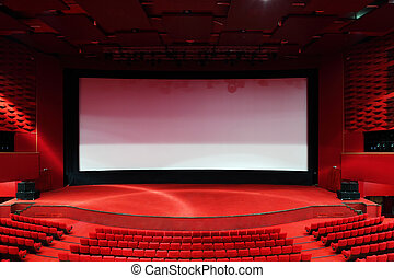 High-angle view of screen and rows of comfortable red chairs in illuminate red room cinema