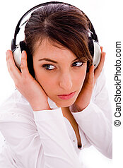 high angle view of serious woman listening music in...