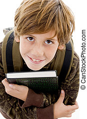 high angle view of smiling school boy looking at camera on...