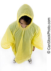 high angle view of standing man wearing raincoat on an...