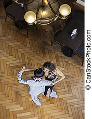High Angle View Of Tango Dancers Performing On Wooden Floor