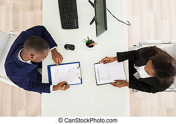 Two Businesspeople Working In Office