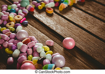 High angle view of various candies on table