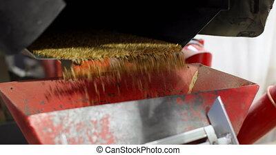 High angle view of wheat thresher machine in warehouse 4k - ...