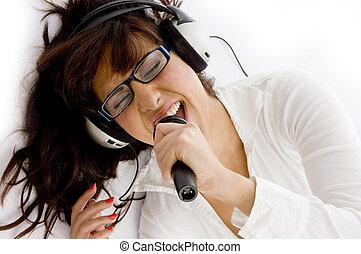 high angle view of woman enjoying music