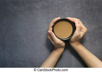 high angle view of women holding coffee cup.