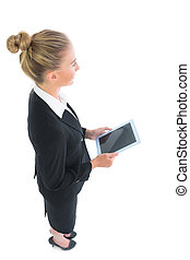 High angle view of young businesswoman holding her tablet