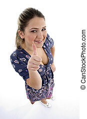 high angle view of young girl showing thumb up with white...