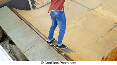 High angle view of young man doing skateboard trick on edge ...