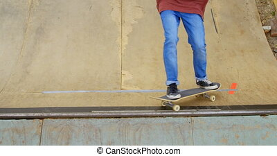 High angle view of young man doing skateboard trick on skateboard ramp at skateboard court 4k