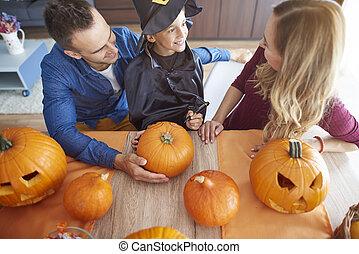 High angle view on family over halloween table